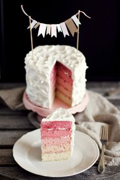 We love this modern gender reveal cake that uses pink just right in an ombre design. | Call Me Cupcake