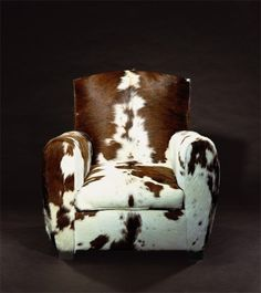 Cow...I want this chair.  Maybe more than that, I want cowhide reupholstering on my favorite Broyhill chair.