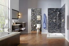 So chic! I love the tile design in this modern bathroom; great touches of natural color with the wood.