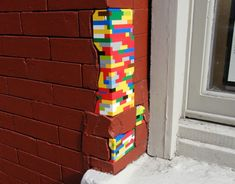 Vormann identifies damaged buildings and plugs the gaps with brightly colored Lego bricks.    Read more: Artist Jan Vormann Uses Legos to 'Repair' War-Damaged Buildings | Inhabitat - Green Design Will Save the World
