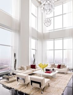 A Luceplan USA light fixture shimmers in the double-height living room of a Manhattan penthouse by ODA-Architecture ~ cynthia reccord