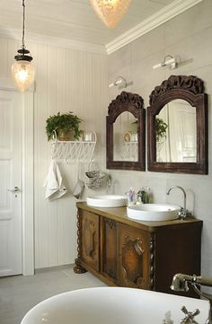 Love the mirrors and the dresser like vanity but not into vessel sinks.