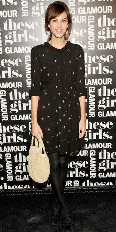 Alexa Chung took in a performance of These Girls wearing an embroidered dress, woven tote and suede flats.