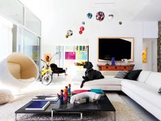 An eclectic mix of art and furnishings, including Eero Aarnio's 1966 Ball chair and an Antonio Citterio cocktail table for B Italia, artwork by Richard Serra and Sean Duffy, as well as Kerns's Blue Great Dane, Jasper.