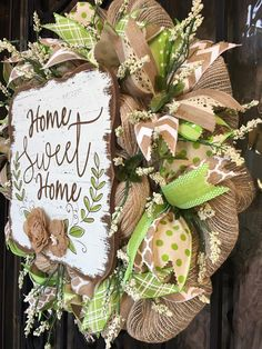Beautiful wreath with rustic charm! The wreath is made on a tan work wreath with a full bolt of jute, poly mesh as the background. The wreath is decorated with an assortment of beige, cream and green premium, wired, decorator ribbons in coordinating prints. Cream berry sprays are wired