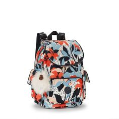 The small Kipling City Pack backpack is a real delight, combining style and practicality all in one. This small backpack comes in a range of tones and prints with patent trims and shiny silver details creating an elevated Kipling twist. This charming little backpack has a multitude of easy reach pockets and plenty of space inside to store all your favourite essentials in style.