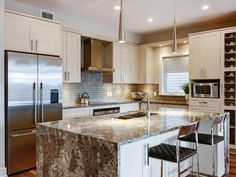 The surprising spacious Quail bungalow features an upgraded waterfall granite island in the kitchen.