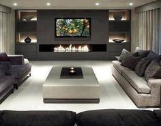 Very modern, clean lines in this media room. It's nice to see, when most are very old-time opulence. ~DK