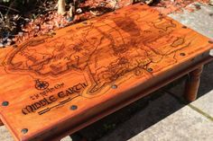 An Indian Sheesham Coffee Table designed with the map of Middle Earth engraved on the surface using