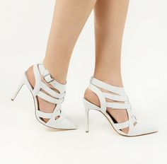 Strappy White Pumps.