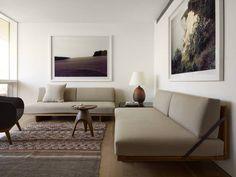Hamptons - Living Rooms - ELLE DECOR Robert Stilin Stilin chose midcentury furnishings and natural materials for the space, which he paired with contemporary photography by H & D Zielske.