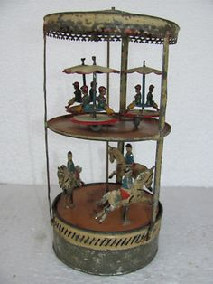 Early hand-painted windup double deck carousel tin toy, c.1910, Germany