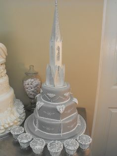 WEDDING CAKE BY KC WEDDING CAKES GRIMSBY LINCOLNSHIRE.Kim specializes in ROYAL ICING,this WEDDING CAKE is decorated with ROYAL ICED lace work and has a modern shimmer look with a touch of cake glitter on the soft silver.The steeple illuminates.See mo 100