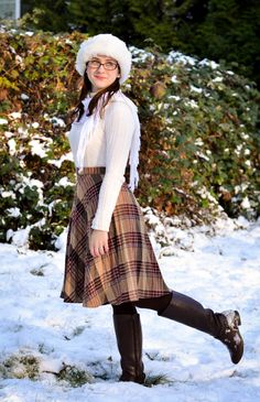 Finery and Madness | winter outfit in neutrals with vintage plaid skirt, riding boots, fur hat