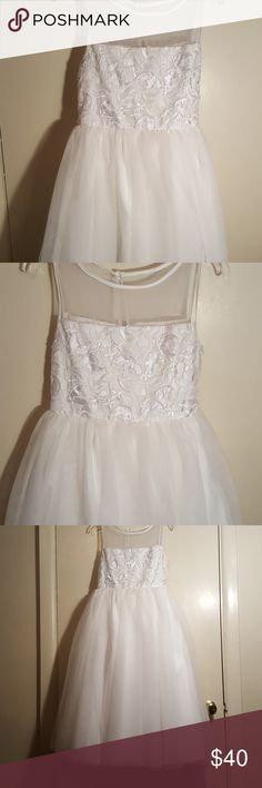 White Formal dress White formal dress with floral detail at the top and flare bottom Marmellata Dresses Formal