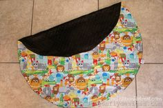 Play Mat Bag Tutorial - The Ribbon Retreat Blog | Play mat with a drawstring so that when the kids are done playing (think Legos), you can just close up the bag with all the toys inside.