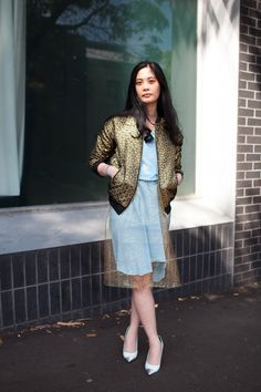 what a fabulous gold-sheer-netting layering situation. And the jacket. Coming up golden Zarene. In Sydney.