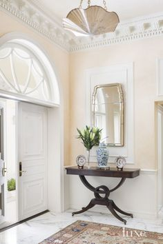 Traditional Cream Foyer with Crown Molding <3