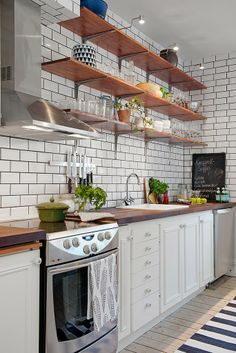 Make It Work: Smart kitchen design solutions for narrow galley kitchens cabinet open cubbies above the cabinets for stashing cookbooks and infrequently used appliances. small kitchen decor for kitchen ideas & inspiration. Kitchen Shelves, Kitchen Dining, Kitchen Decor, Kitchen Cabinets, Open Shelves, Kitchen White, Dark Cabinets, Upper Cabinets, Kitchen Storage