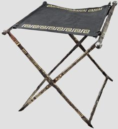 A late Roman Sella Castrensis folding chair for a commander, 3rd/4th cent AD  Wrought iron with floral and geometrical bronze inlays. Height 44 cm, dimensions approximately 40 x 57 cm.  The richly decorated folding chair stands in the tradition of ancient Italic commander's insignia.