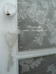 little window with lace                                    Thinking....maybe I could do this over an old screen door...?