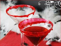"""Vampire Kiss Martini (reposting to place in proper album)  1 part vodka, chilled  1 part Champagne  1 part Chambord    How to make """"dripping blood"""" red candy rim  Ingredients:  1 c. Sugar  1/2 c. Karo Syrup  1/2 c. Water  Red Food Coloring    Directions:  Combine sugar, syrup and water. Cook without stirring to hard crack stage – which is 300 degrees F. Add food coloring.  Turn off heat. While the mixture is still hot, dunk the top of the cocktail glass into the mixture to create the red…"""