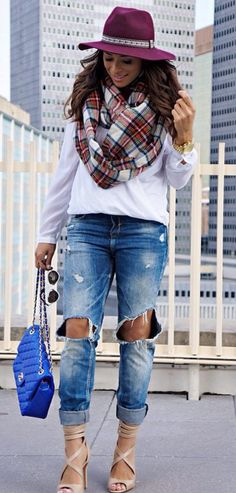 Cosy Fall look, go causal chic wearing distressed denim, seater and an oversized scarf.