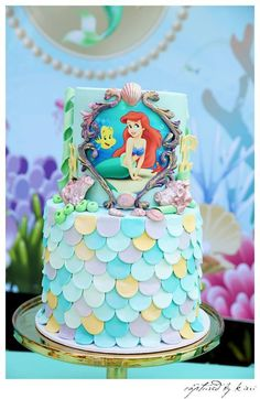 Little Mermaid Party details to LOVE… ♥ Spectacular two tiered Little Mermaid themed birthday cake♥ Under the sea backdrop with Ariel ♥ Beautiful balloon arch including flowers surrounding the backdrop♥ Mermaid tail cake pops♥ Mermaid tail cupcakes♥ Little Mermaid personalised chocolates♥ Mermaid party props and more!♥ Setup & Styling Stylish Events & Decorations Props By …Read more...