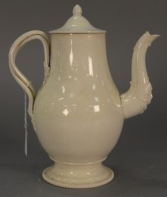 English creamware coffee pot having round cover over slender bulbous ... Lot 273