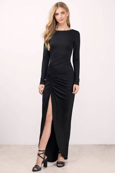 You'll fall in love with the Tyren High Slit Maxi Dress. Featuring a high front slit and low back. Pair with lace up heels and statement jewelry.
