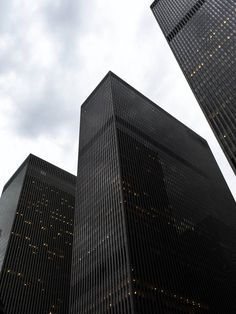 """The so-called """"XYZ Buildings,"""" Midtown Manhattan, New York City, New York, USA. L to R: 1211 (News Corp. Building), 1221, and 1251 Avenue of the Americas (6th Avenue) between West 47th Street and West 50th Street. These three buildings are right around the corner from the Rockefeller Center. https://www.google.ca/maps/place/1221+6th+Ave,+New+York,+NY+10020,+USA/@40.7593952,-73.9834104,17z/data=!4m5!3m4!1s0x89c258ff30e8a08d:0x3fdbc2cc0ef5407c!8m2!3d40.7594099!4d-73.98222"""