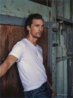 Embracing casual style, Matthew McConaughey sports a white tee.