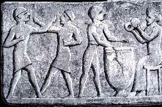 Figure 3. Terracotta relief depicting two men boxing to musical accompaniment, c. 1200 B.C.E., Sinkara (modern-day Tell as Senkereh, Iraq).