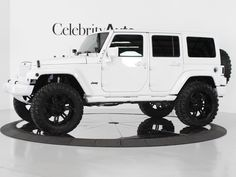 white 4 door jeep wrangler. I prefer the black soft top but I like white too