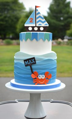 Children's Birthday Cakes - Fun 2 year old birthday cake with waves, sailboat and crab.