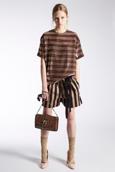 We always pack our stripes for a weekend getaway, and on our next trip, we'll be mixing and matching to create a shorts look that's way more interesting than your typical matching set. Throw in some sunnies, subtract the socks, and we've found our Insta-ready vacation uniform.Rochas #refinery29 http://www.refinery29.com/2016/06/112646/cruise-fashion-2017#slide-6