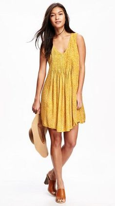 Think flowy dresses can't be sophisticated? Girl, pleats. Introducing the pleated crepe dress, or as we like to think of it, your new go-to dress. This little yellow number is sweet with just the right amount of sass. Appropriate for the office, adorable for date night, affordable for your bank account, this dress does it all. We like it paired with brown chunky heels and a felt panama hat.