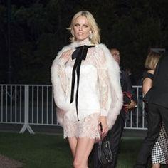 Eva Herzigova showcases her pins in white fur and lace leotard dress at Venice FF