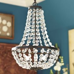 "for $170 this would be a great base for DIY chandy with shells. Camille Chandelier  | Lighting | Ballard Designs  Dimensions: Overall: 20 3/4""H X 14"" Diameter Ceiling Canopy: 5"" Diameter Chain: 6'L Construction: Made of steel with glass crystal beads. Lighting: Uses type B 40W max candelabra bulbs. Cord is 10'L and black. Country of Origin: China Additional Information: Some assembly required."
