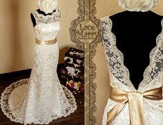 Deep V-Cut Back Vintage Style Lace Wedding Dress Features Illusion Neckline and Satin Sash. $284.00, via Etsy.