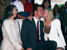 Patsy Swayze looks on as son Patrick Swayze gets a kiss from wife Lisa Niemi.