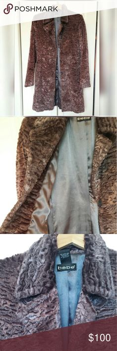 Bebe heavyweight fur coat   New never worn SALE This is just beautiful , third pic is accurate color , so soft , heavyweight , satin lined , just beautiful   Silvery  kinda somewhat of a purplish hue but looks dark gray    Soft furry exterior   ( not real fur ) bebe Jackets & Coats Trench Coats