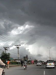 Busy highway with cars and motorbikes, under a cloudy skyGrand Trunk Road in Gujranwala