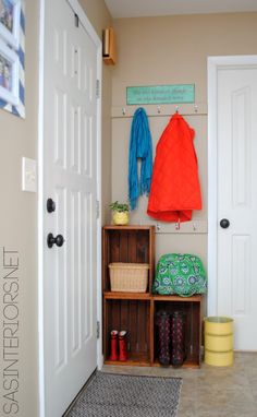 Easy Entry Upgrade with DIY built-in coat hooks and wooden crates