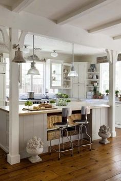 Kitchen island... like the two beams. Would be nice to have faux beams...?