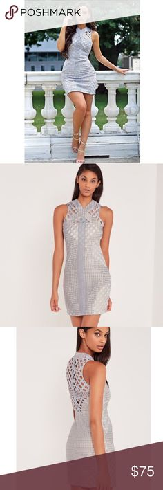Carli Bybel for Missguided Lace Cut Out Dress Carli Bybel for Missguided lace cut out cross neck body con dress in grey. Runs small. Tag shows SIZE 6, but runs more like a SIZE 4. Back zipper. Never been worn. No trades. No PayPal. Instagram: CitrusandLavenderlane Missguided Dresses