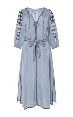 This embroidered chambray dress from **Ulla Johnson** features two self-tie fringe details at front, smocking details, embroidered…