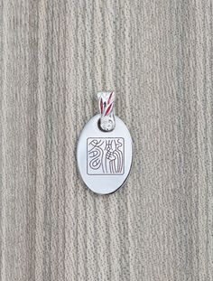 """Titanium pendant with engraved and enameled chinese characters.( """"To live as long as cranes"""") by KaeiStore, ¥8000"""