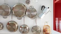 7 Brilliant Kitchen Storage Solutions -- adhere magazine holder inside cabinet door to store foil boxes and more
