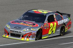 Jeff Gordon wheeled a special DuPont paint scheme to victory at Homestead Miami Speedway in the NASCAR Sprint Cup Series season finale. This 20 Years design was created by NASCAR artist Sam Bass and will never be raced again.